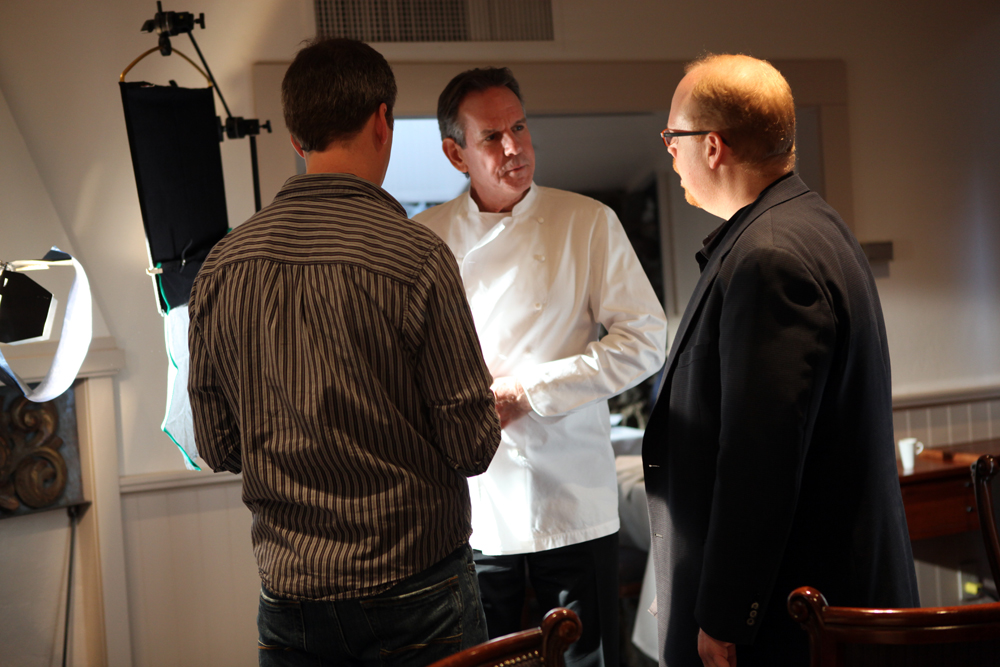 Director Joseph Levy prepares Chef Thomas Keller for his interview. Photo courtesy of Spinning Plates