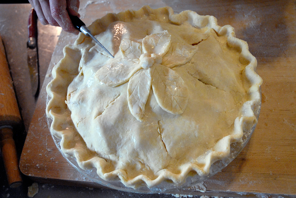 """Add pastry leaves and dough ball """"berries."""" Using a sharp knife, slash top crust in several places to let steam escape. Photo: Wendy Goodfriend"""