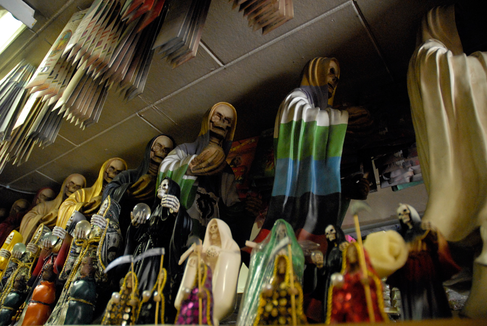 Santa Muerte statues inside Botanica Los Sueños in San Francisco's Mission District. Photo: Wendy Goodfriend