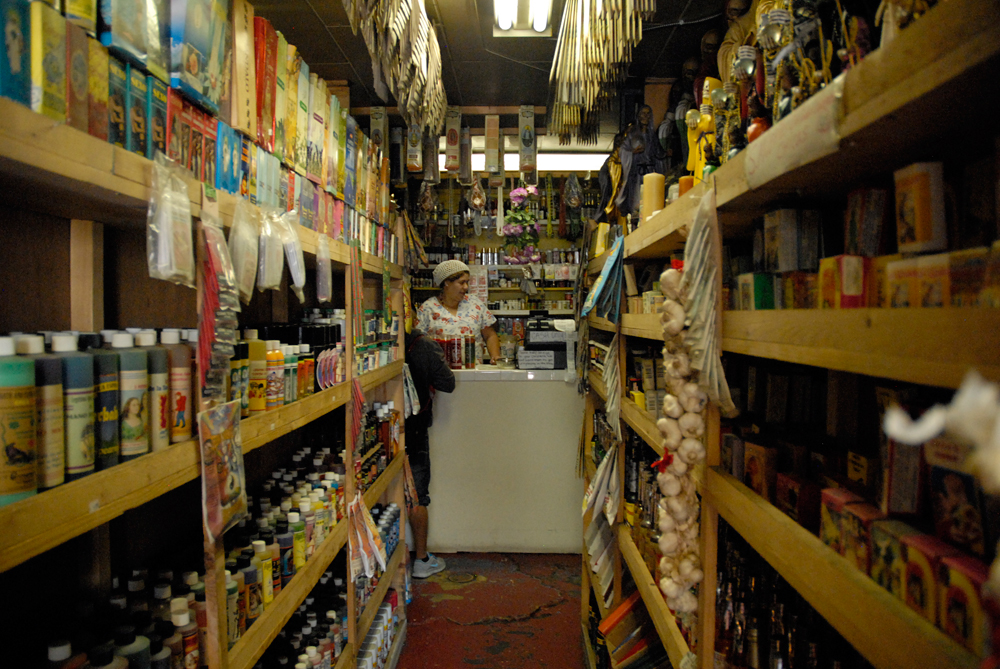 The walls of Lupe's shop are lined with rows and rows of prepackaged herbal blends.