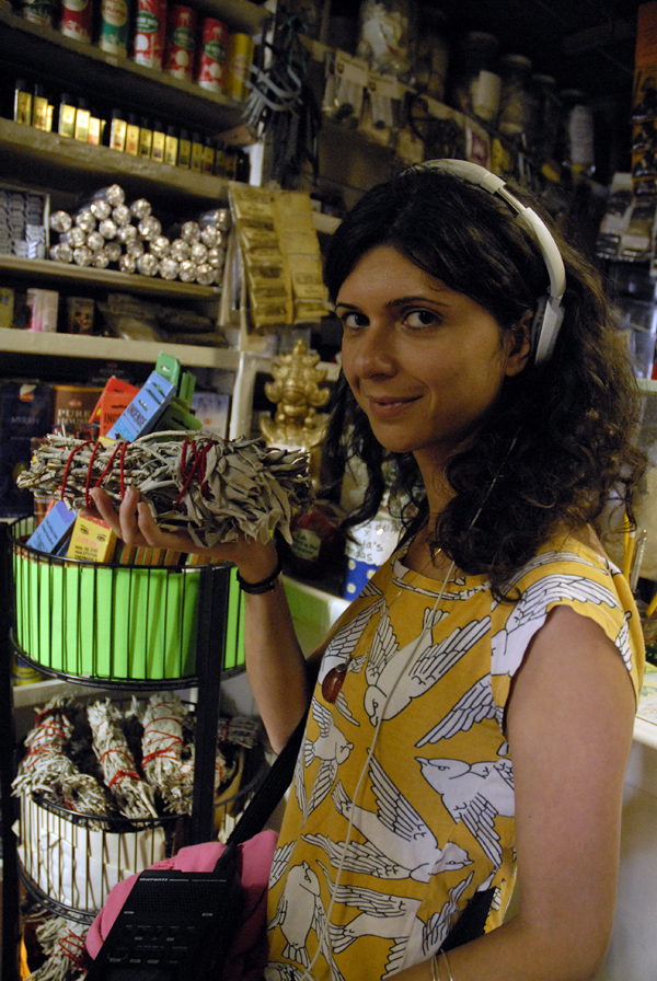 Shuka Kalantari holds sage at Botanica Los Sueños. Photo: Wendy Goodfriend