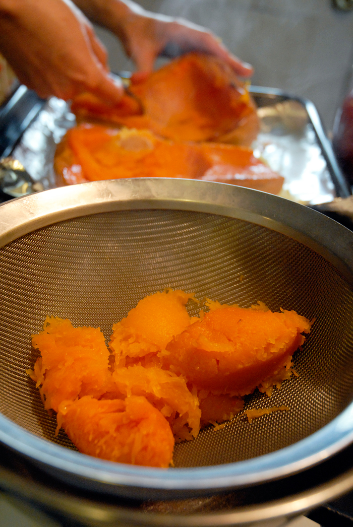Once the squash is cool enough to handle, scrape the flesh out of the skin. Photo: Wendy Goodfriend