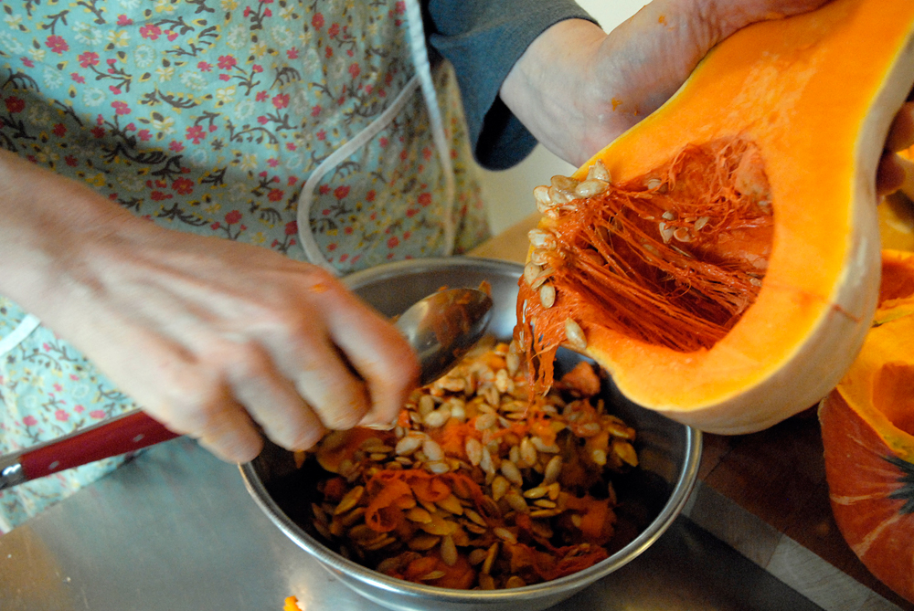 Using a spoon, scrape out the seeds and strings. Photo: Wendy Goodfriend