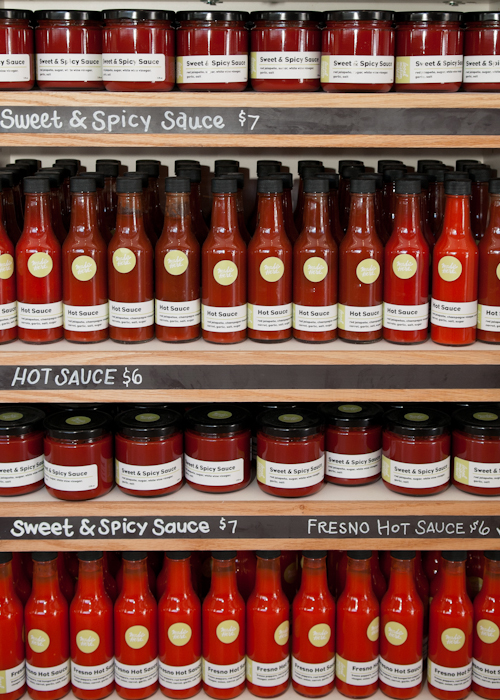 Numerous varieties of hot sauce. Photo: Naomi Fiss