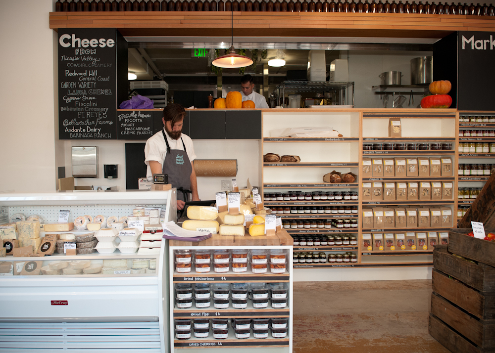 Cheese counter, pickles and fresh pasta shelves with view of kitchen. Photo: Naomi Fiss