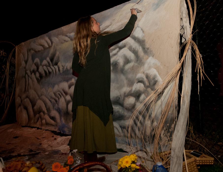 Performance piece: woman painting the heavens. Photo: Naomi Fiss
