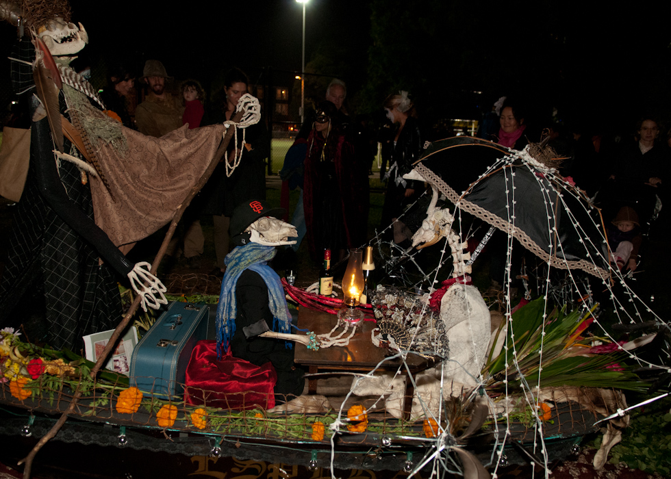 Romantic skeletons having a glass of wine in a boat. Photo: Naomi Fiss