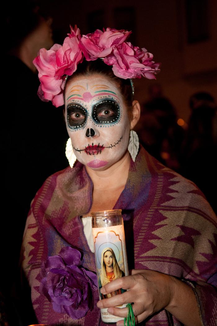 Woman with pink flower headdress. Photo: Naomi Fiss
