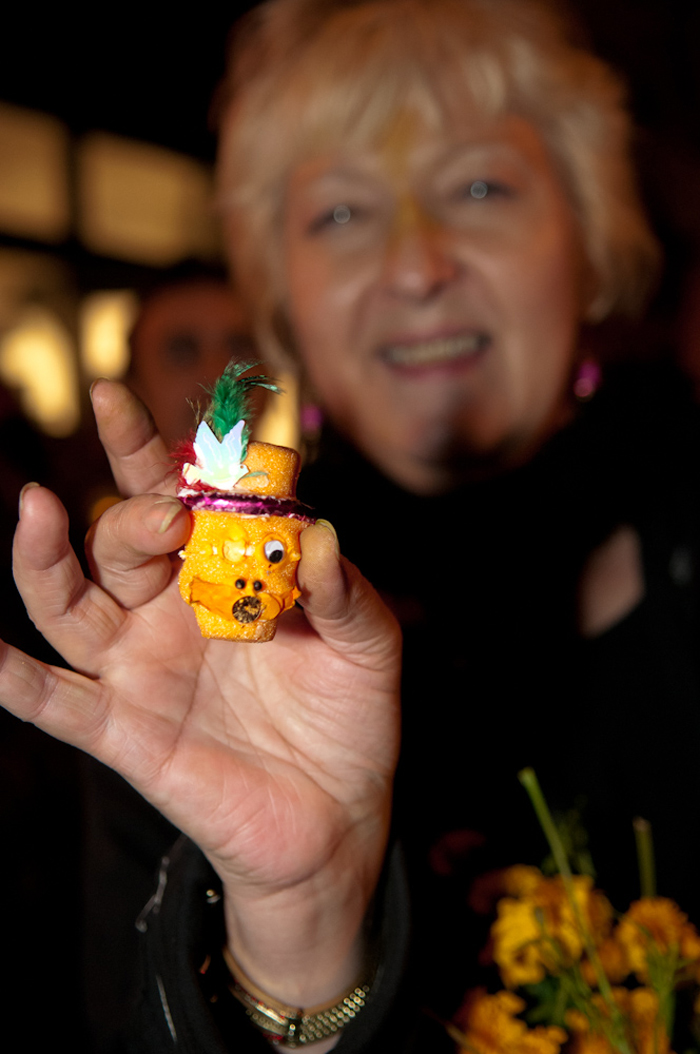 Mini sugar skull being given gifted out during procession. Photo: Naomi Fiss