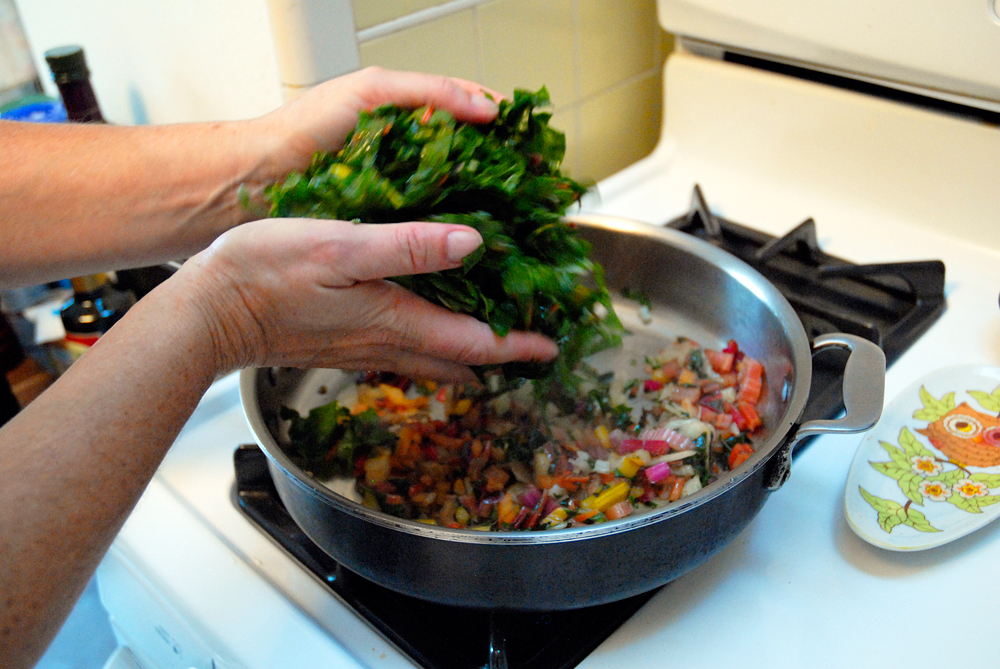 Add the leaves and sauté until tender and wilted. Photo: Wendy Goodfriend