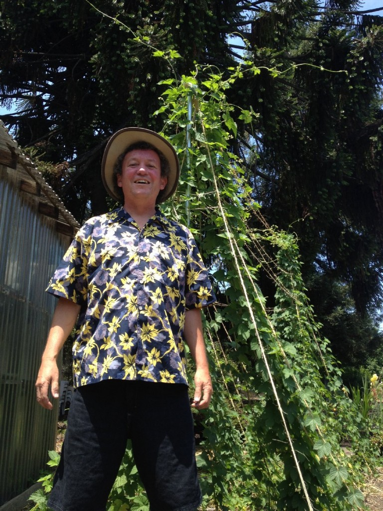 Cabrera poses next to the vines that grew nearly 40-feet-high this summer. Photo: Mark Cabrera