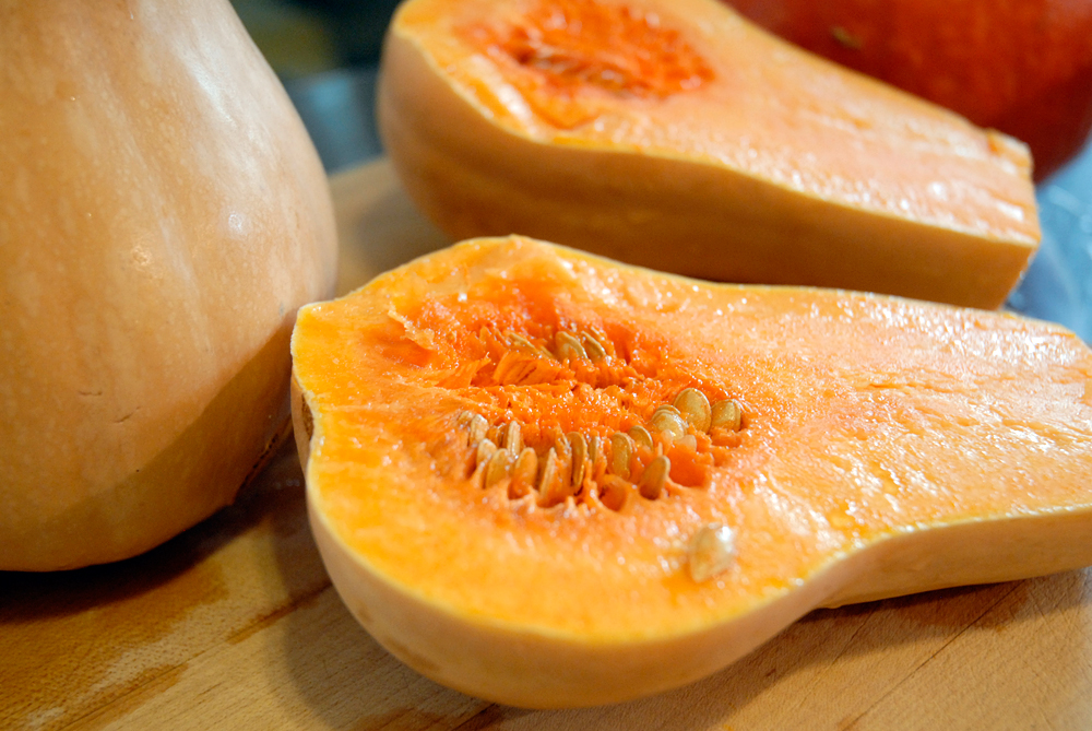Slice the stems off and half the butternut squash lengthwise. Photo: Wendy Goodfriend