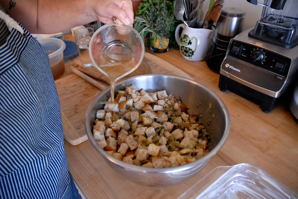 Douse with enough chicken stock to moisten the stuffing. Photo: Wendy Goodfriend