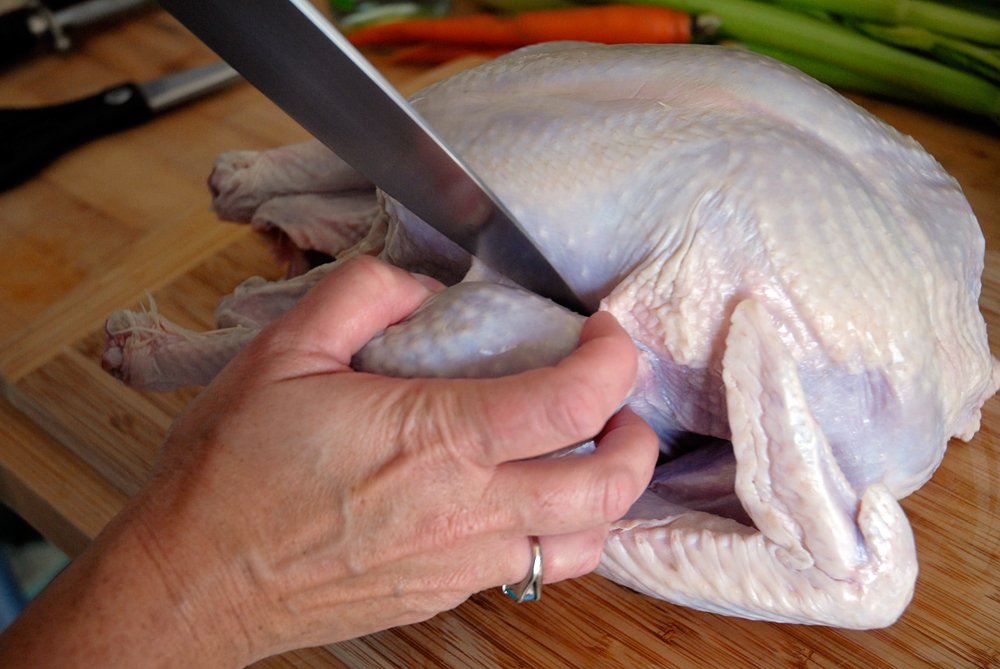Use sharp knife to separate leg and thigh from breast. Photo: Wendy Goodfriend