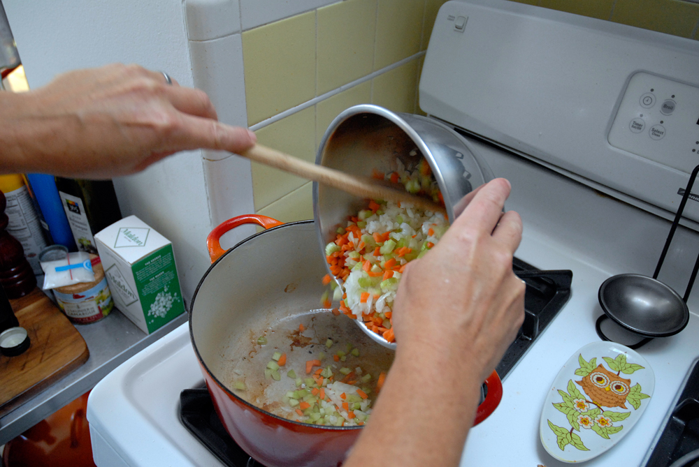 Add diced onions, carrots and celery to dutch oven. Photo: Wendy Goodfriend