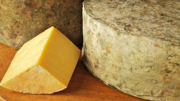 Shelburne Farms' clothbound cheddar has a bright yellow color because it's made from the milk of cows that graze on grasses high in beta-carotene. Photo: Courtesy of A. Blake Gardner