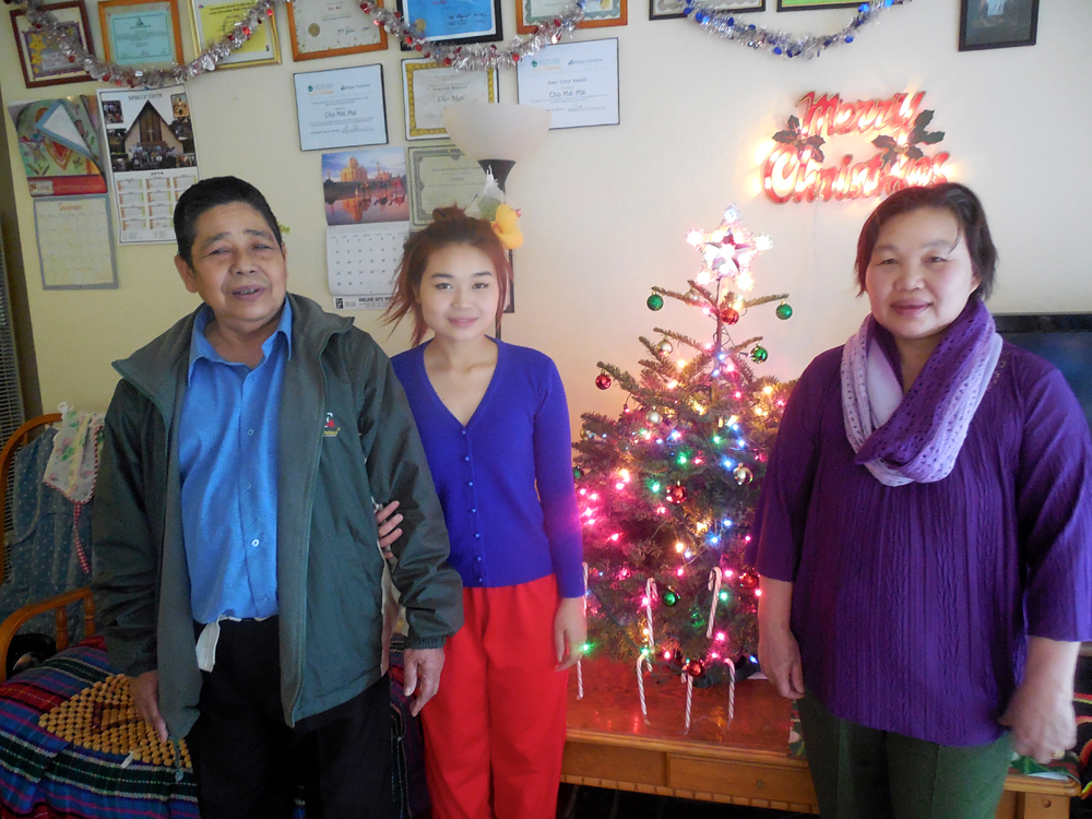 Cho Mei and parents: Cho Mei and her parents bought their first Christmas tree this year. Cho Mei says she's even doing a Secret Santa with her family – something she learned from her Burmese church group in Oakland. Photo: Shuka Kalantari