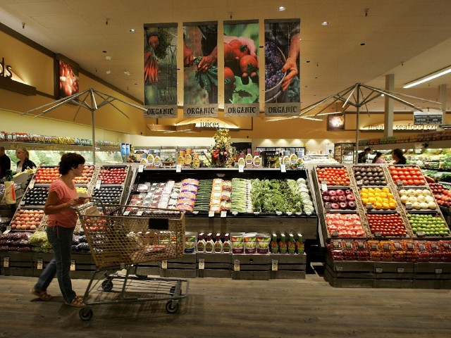 A Safeway customer browses in the fruit and vegetable section at Safeway in Livermore, Calif. Photo: Justin Sullivan/Getty Images
