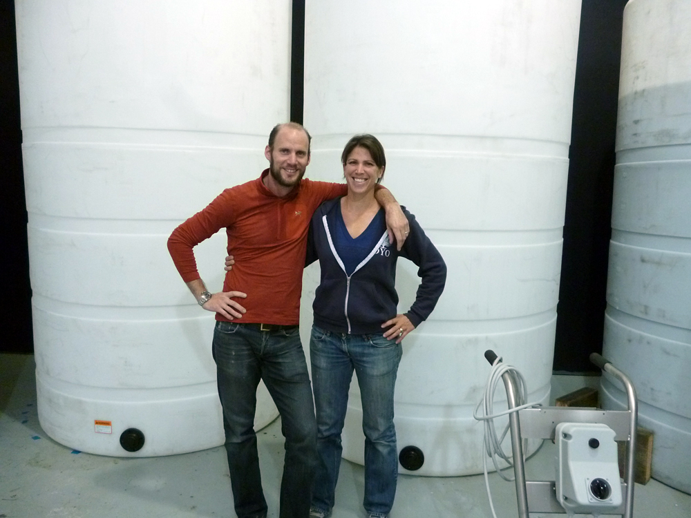 Oron Benary and Sarah Jones of the San Francisco Mead Company in front of tanks. Photo: Stephanie Rosenbaum