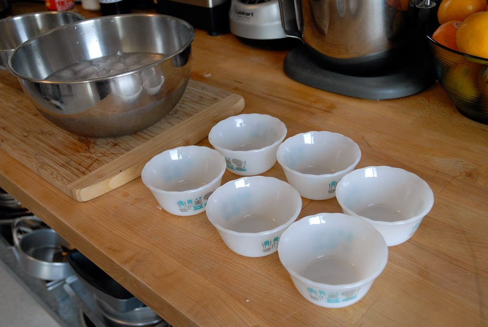 Fill a larger bowl half full with ice and cold water (ice bath). Have ready six 1/2-cup custard cups. Photo: Wendy Goodfriend