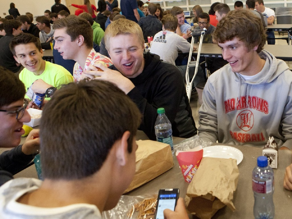 Students at Lowell High School in Michigan sit down for lunch. Shorter lunch breaks mean that many kids don't get enough time to eat and socialize. Photo: Emily Zoladz/Landov