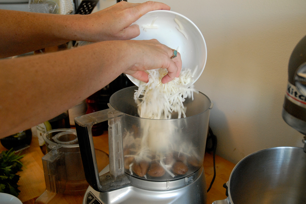 Add grated goat cheese. Photo: Wendy Goodfriend