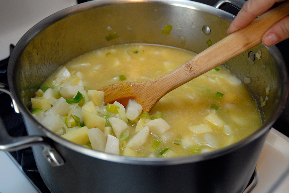 Add the chicken broth bring to a boil over high heat, then lower the heat and simmer. Photo: Wendy Goodfriend