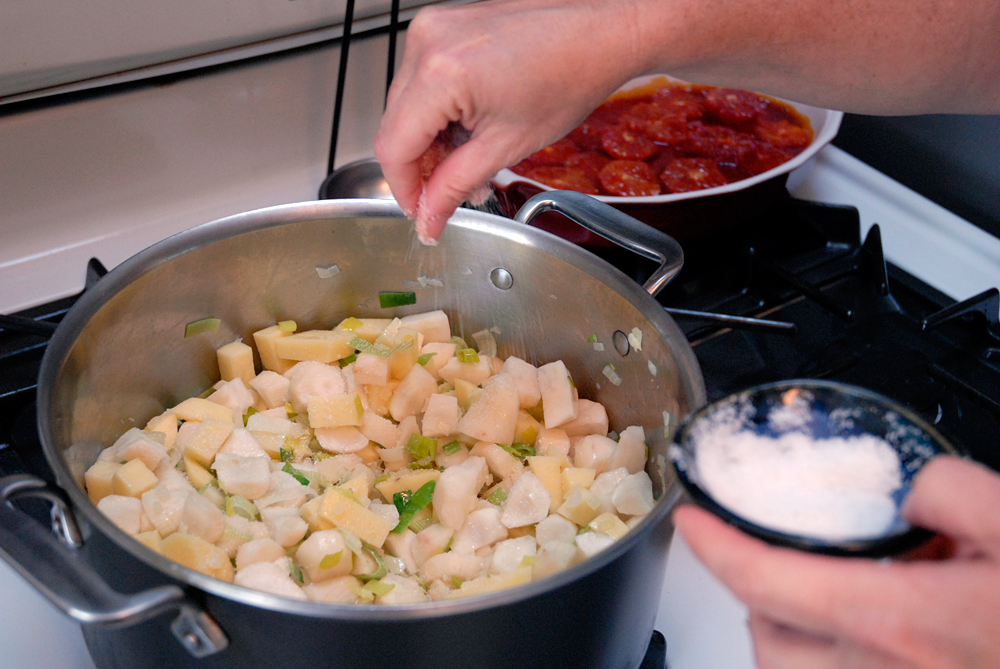Add another glug of olive oil, season with salt. Stir well and cook until the vegetables begin to glisten, about 10 minutes. Photo: Wendy Goodfriend