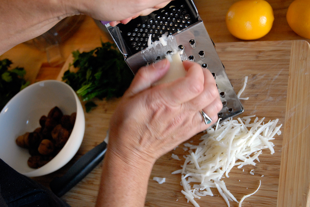 Grate the goat cheese. Photo: Wendy Goodfriend