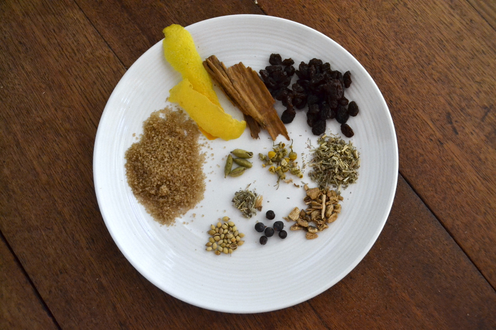 My sweet vermouth recipe includes (from far left, moving clockwise): turbinado sugar, orange peel, lemon peel, Ceylon cinnamon, raisins, wormwood, gentian root, juniper berries, coriander seeds, dried sage, cardamom pods, and chamomile. Photo: Kate Williams