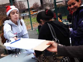 Amal Mimish, an organizer with Good Jobs Nation, registers protesters at the fast-food-workers' rally in Washington, D.C., on Thursday. Photo: Morgan Walker/NPR