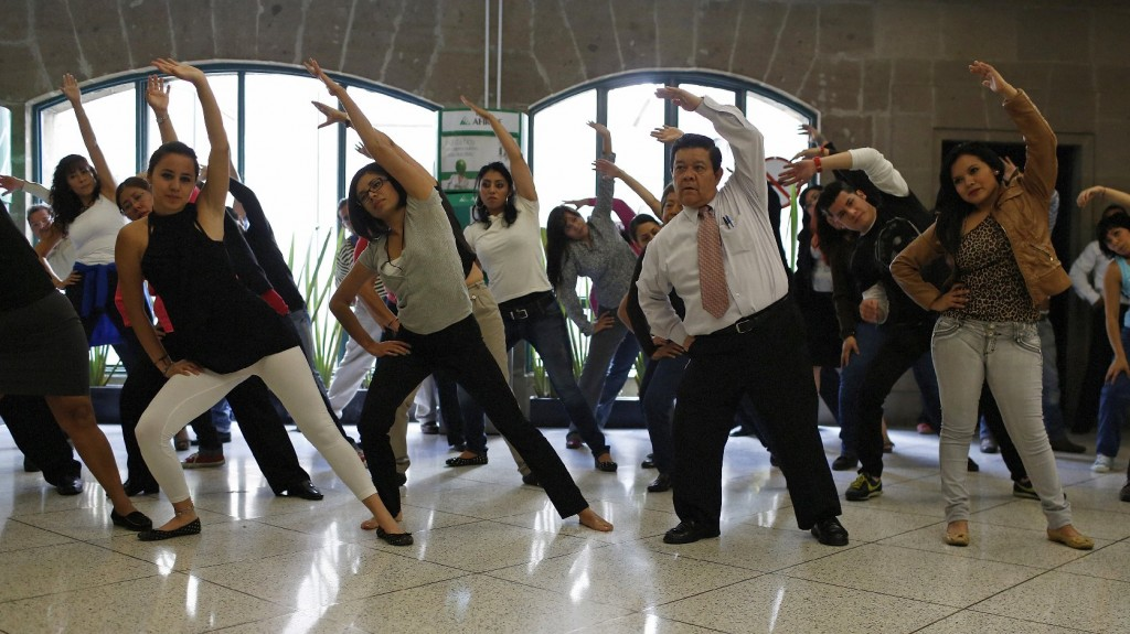 Government workers exercise at their office in Mexico City, August 2013. To counter the obesity epidemic, the city requires all government employees to do at least 20 minutes of exercise each day. Photo: Tomas Bravo/Reuters /Landov