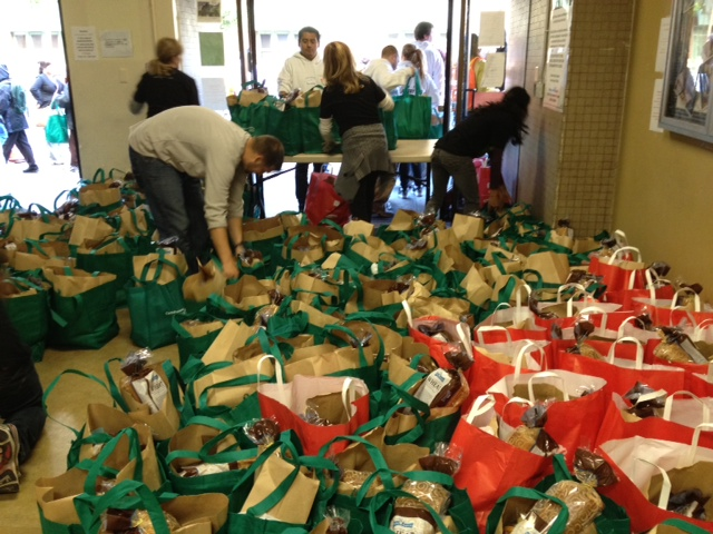 In December, GLIDE gave away thousands of gift grocery bags filled with fresh poultry, a loaf of bread and cans of beans and corn. Photo: Mina Kim/KQED