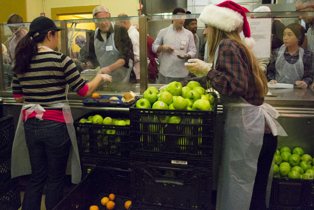 155 volunteers helped serve 3,000 meals on Christmas Eve at GLIDE. Photo: Sara Bloomberg/KQED