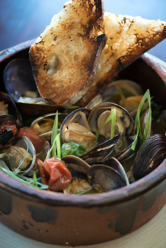 Fog City wood oven clams with sake butter, padrones and cherry tomatoes. Photo: Kristen Loken
