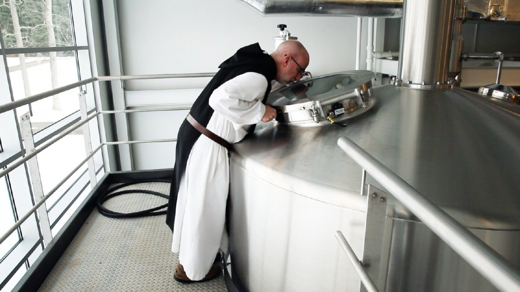 A monk at St. Joseph's Abbey inspects the boil. Photo: Nick Hiller/The Spencer Brewery