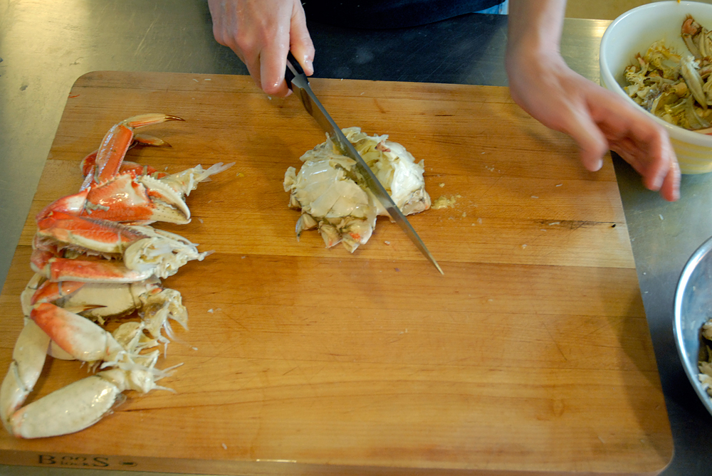 Using a sharp, heavy knife or cleaver, hack the body in half. Photo: Wendy Goodfriend