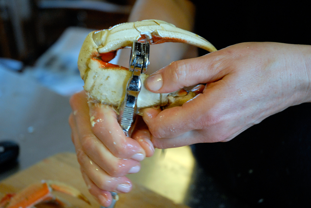 Using a crab cracker, crack the claws along the joints and midsection. Photo: Wendy Goodfriend