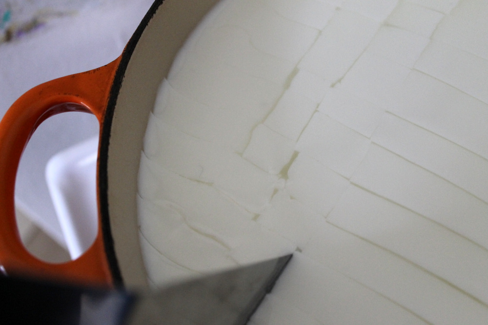 Cutting the curd into small cubes allows it to release whey and form solid cheese. Photo: Kate Williams
