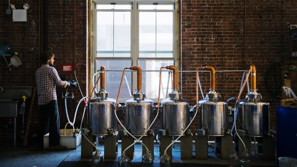A worker at New York's Kings County Distillery, which opened in 2010. Before going legit with the operation, co-founder Colin Spoelman (not pictured) learned to make moonshine in his Brooklyn apartment without a permit. Photo: Courtesy of Valery Rizzo