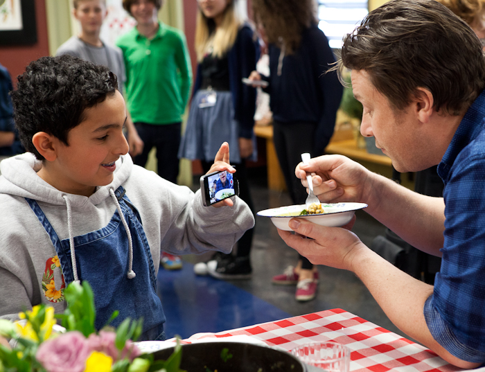 Jamie Oliver tucks into a bowl of black-eyed peas. Photo: Erin Scott