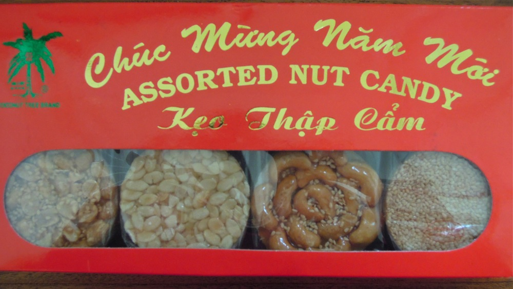 Happy New Year proclaims this box of nut and seed cookies, a traditional snack for the Vietnamese celebration of Tet