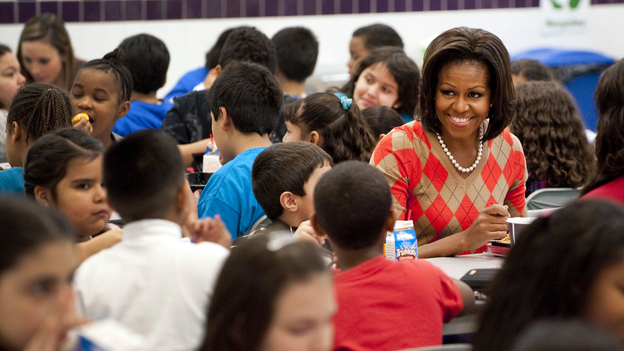 Michelle Obama eats lunch with school children at Parklawn Elementary School in Alexandria, Va., in 2012. The first lady unveiled new guidelines Tuesday aimed at cracking down on the marketing of junk food to kids during the school day. Photo: Saul Loeb/AFP/Getty Images
