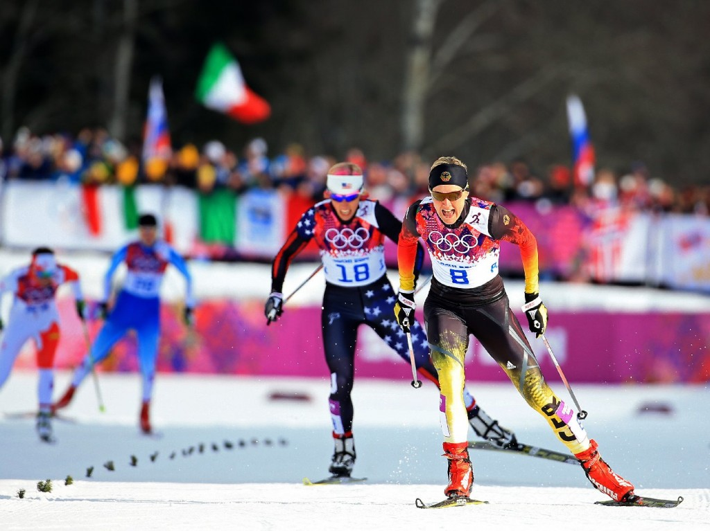 Kikkan Randall of the United States (left) and Denise Herrmann of Germany compete in the finals of the Ladies' Sprint Free during the Sochi 2014 Winter Olympics in Russia. (Richard Heathcote/Getty Images)
