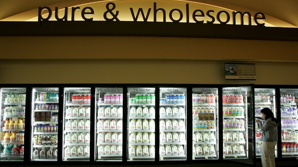 A customer shops for milk at a Safeway in Livermore, Calif. Although it may seem counterintuitive, there's growing evidence that full-fat dairy is linked to reduced body weight. Photo: Justin Sullivan/Getty Images