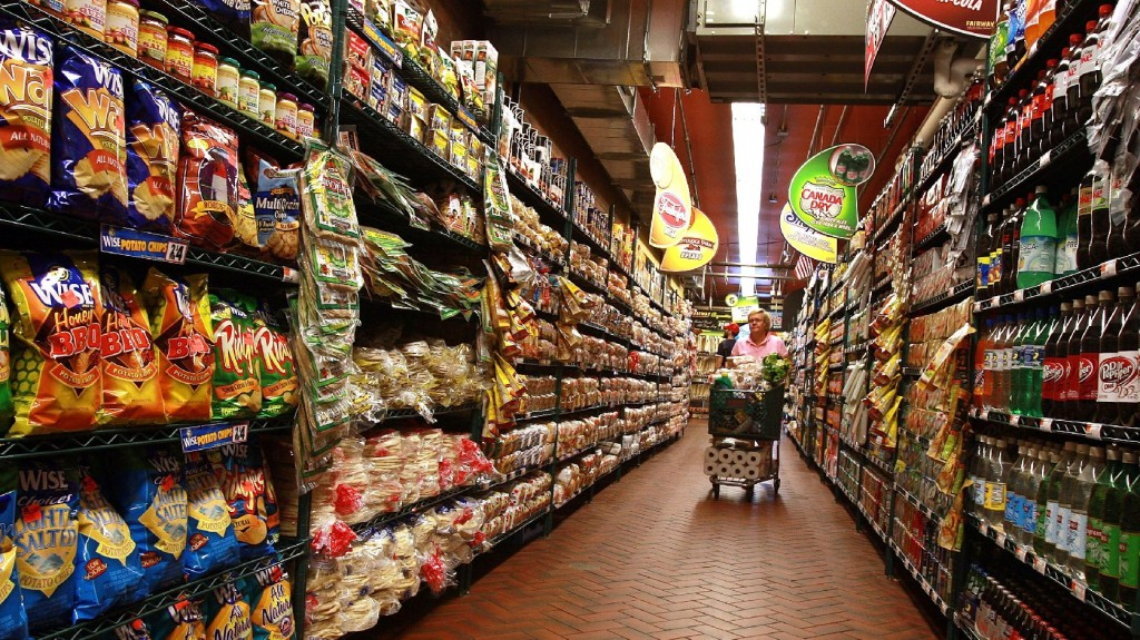 A woman shops at a grocery store in New York City. Photo: Spencer Platt/Getty Images