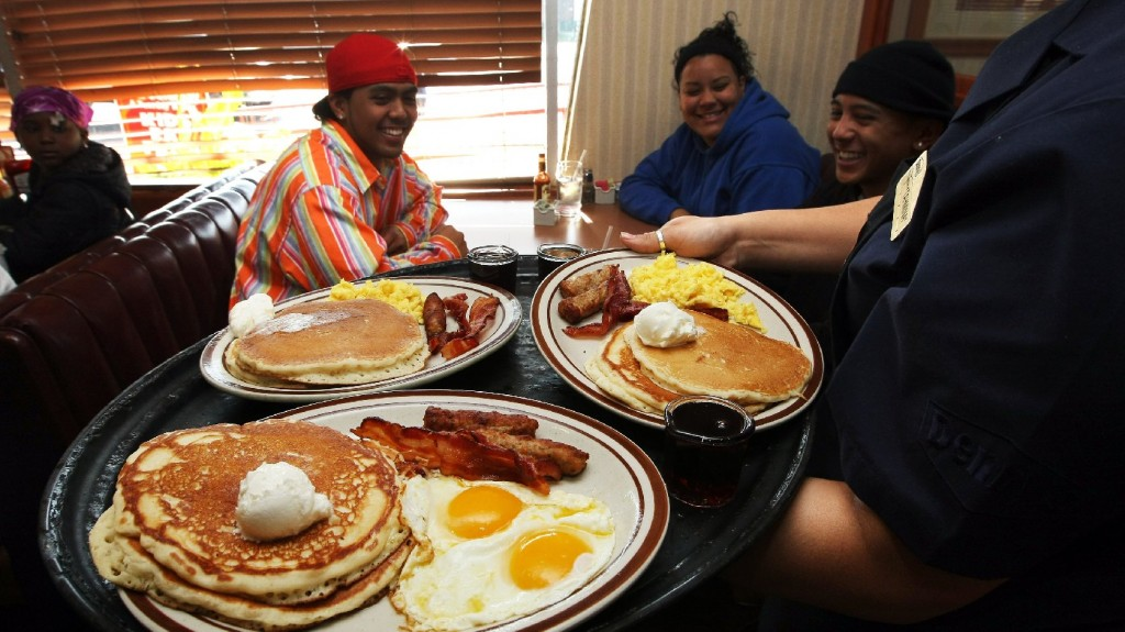 A Denny's waitress delivers breakfast to customers in Emeryville, Calif. The tipped minimum wage has been stuck at $2.13 since 1991. Photo: Justin Sullivan/Getty Images