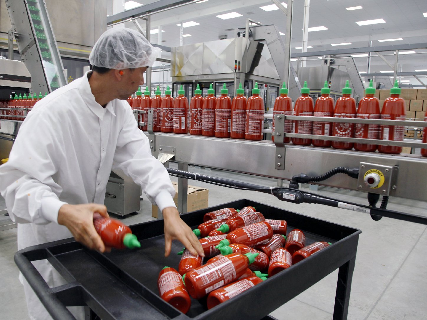 Sriracha chili sauce is produced at the Huy Fong Foods factory in Irwindale, Calif. Photo: Nick Ut/AP