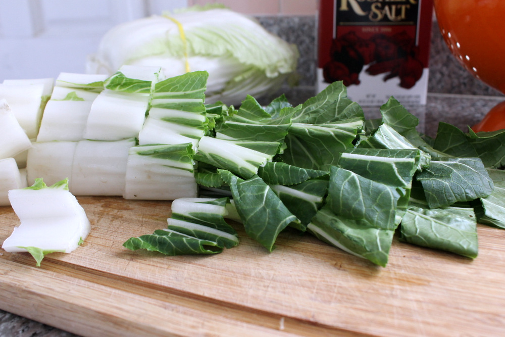 I like to equal parts of bok choy and napa cabbage in my kimchi. I cut each into 2-inch pieces. Photo: Kate Williams