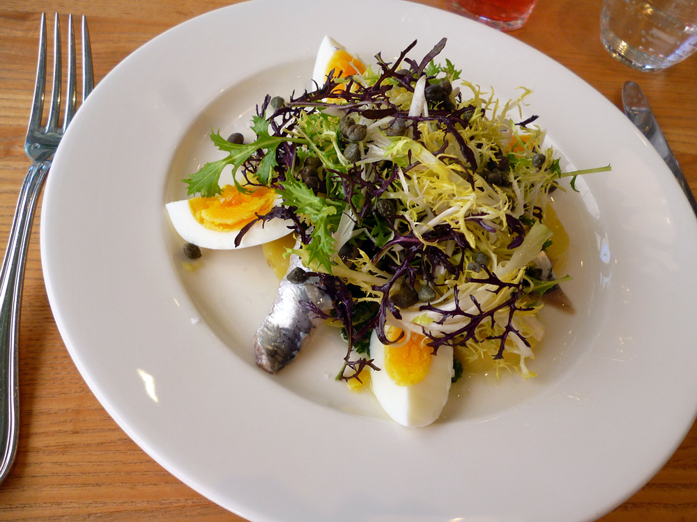At the Shed in Healdsburg, local herring is marinated in housemade red wine vinegar and olive oil, then served in a lunchtime salad with frisee, soft-cooked egg, capers, and boiled potato. Photo: Stephanie Rosenbaum